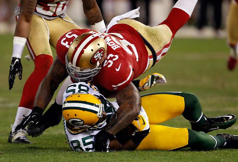 Greg Jennings was taken down by NaVorro Bowman on Saturday and could be out of Green Bay as a free agent. Photo: Carlos Avila Gonzalez, The Chronicle