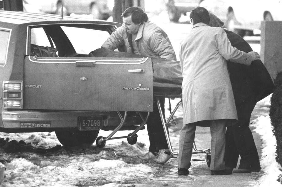 The body of Clare Honablume is removed from the Imperial House Condominiums on Prospect Street in Stamford Jan. 15, 1988. Photo: The (Stamford) Advocate