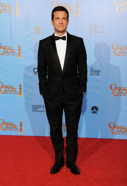 Presenter Jason Bateman poses in the press room during the 70th Annual Golden Globe Awards held at T