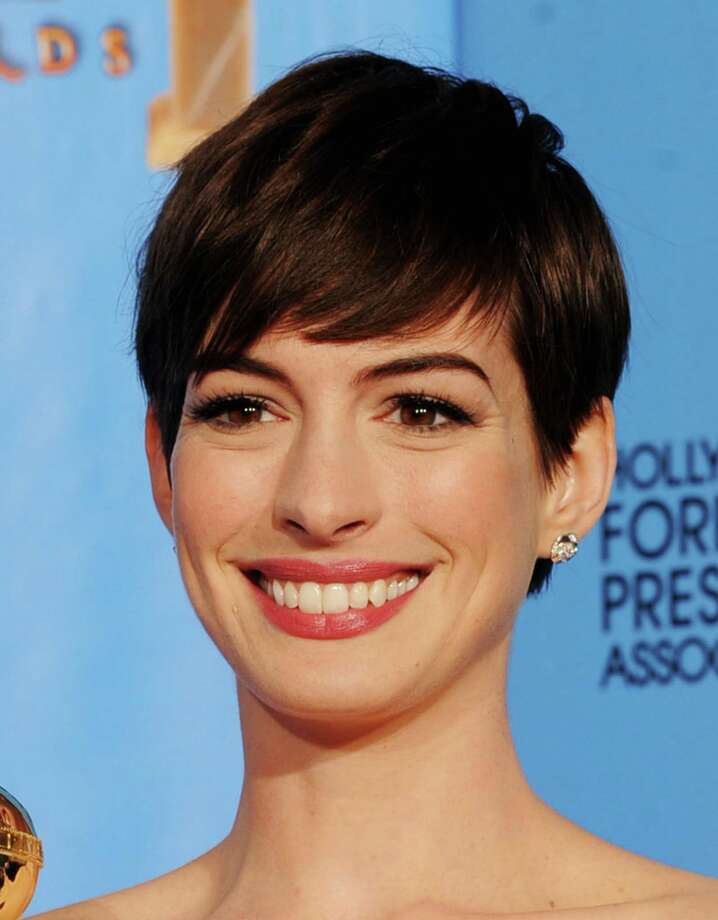 "Actress Anne Hathaway, winner of Best Supporting Actor in a Motion Picture for ""Les Miserables,"" poses in the press room during the 70th Annual Golden Globe Awards held at The Beverly Hilton Hotel on January 13, 2013 in Beverly Hills, California. Photo: Kevin Winter, Getty / 2013 Getty Images"