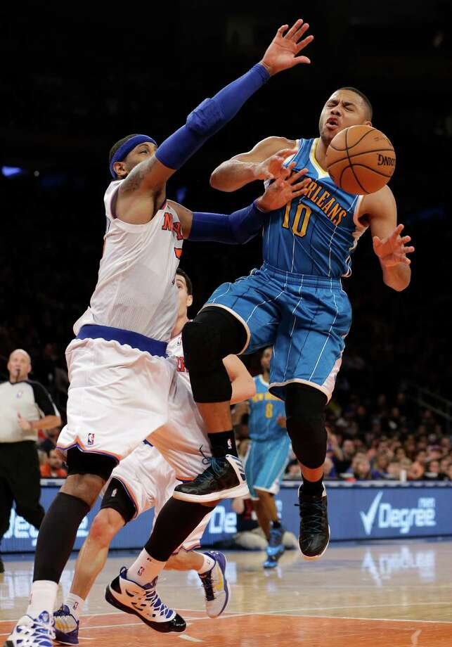 New York Knicks forward Carmelo Anthony, left, knocks the ball away from New Orleans Hornets guard Eric Gordon (10) who was going for a layup in the second half of their NBA basketball game at Madison Square Garden in New York, Sunday, Jan. 13, 2013. (AP Photo/Kathy Willens) Photo: Kathy Willens