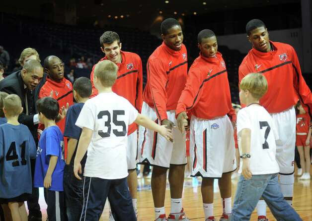 Fairfield men's basketball players greet Newtown students before the start of their game with Niagara at the Webster Bank Arena in Bridgeport on Sunday, January 13, 2013. Photo: Brian A. Pounds