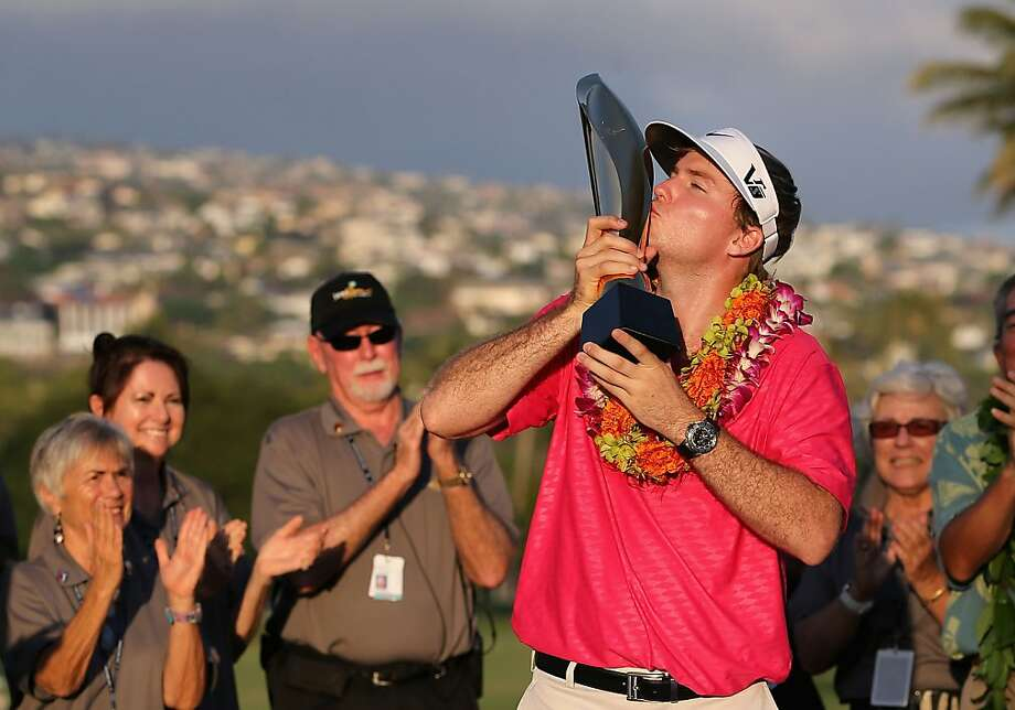 Russell Henley goes from low - a score of 256 over 72 holes - to the high of a first-place trophy presentation. Photo: Christian Petersen, Getty Images