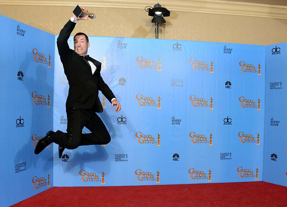 "Director Mark Andrews poses with the award for best animated feature film for ""Brave"" backstage at the 70th Annual Golden Globe Awards at the Beverly Hilton Hotel on Sunday Jan. 13, 2013, in Beverly Hills, Calif. (Photo by Jordan Strauss/Invision/AP) Photo: Jordan Strauss, Associated Press"