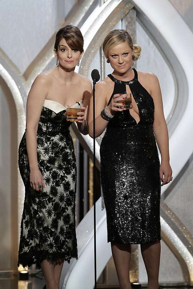BEVERLY HILLS, CA - JANUARY 13: In this handout photo provided by NBCUniversal,  L to R Tina Fey and Amy Poehler host the 70th Annual Golden Globe Awards at the Beverly Hilton Hotel International Ballroom on January 13, 2013 in Beverly Hills, California. (Photo by Paul Drinkwater/NBCUniversal via Getty Images) Photo: Handout, Getty Images