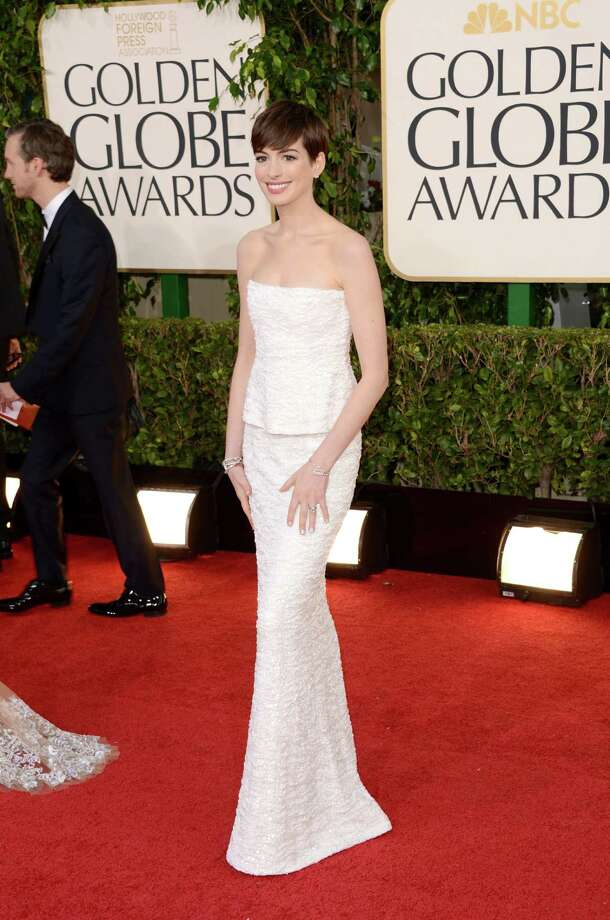 Anne Hathaway scores, winning for ?Les Miserables? and winning the red carpet fashion showdown in a crystal beaded Chanel two piece ensemble. Two words: pixie perfection. Photo: Jason Merritt, Staff / 2013 Getty Images