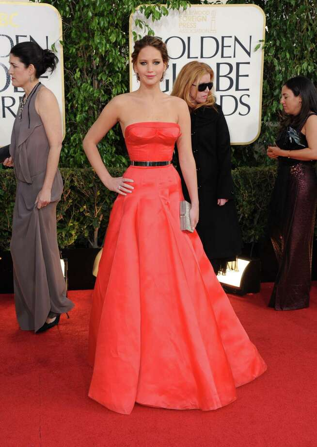 The ?Silver Linings Playbook? star Jennifer Lawrence won a Golden Globe and perhaps some fashion cred for her red Dior Haute Couture princess gown with a tiny belt. Photo: Jordan Strauss, INVL / Invision