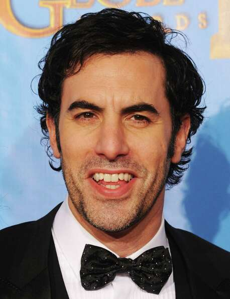 Actor Sacha Baron Cohen poses in the press room during the 70th Annual Golden Globe Awards held at T