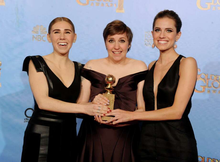 BEVERLY HILLS, CA - JANUARY 13:  (L-R) Actress Zosia Mamet, actress/writer Lena Dunham, and actress Allison Williams pose with Best Series Award in the press room during the 70th Annual Golden Globe Awards held at The Beverly Hilton Hotel on January 13, 2013 in Beverly Hills, California. Photo: Kevin Winter, Getty / 2013 Getty Images