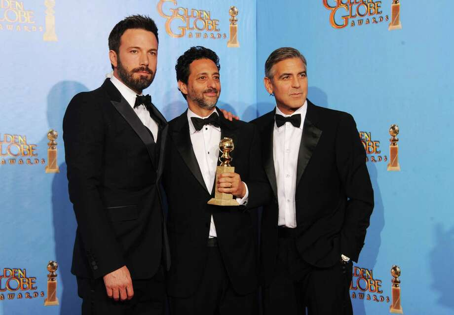 "Actor-director Ben Affleck, producer Grant Heslov and producer George Clooney, winners of Best Motion Picture (Drama) for ""Argo,"" pose in the press room during the 70th Annual Golden Globe Awards held at The Beverly Hilton Hotel on January 13, 2013 in Beverly Hills, California. Photo: Kevin Winter, Getty / 2013 Getty Images"