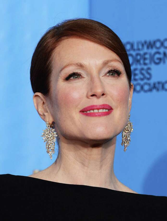 """Actress Julianne Moore, winner of Best Actress in a Mini-Series or a Motion Picture Made for Television for """"Game Change,"""" poses in the press room during the 70th Annual Golden Globe Awards held at The Beverly Hilton Hotel on January 13, 2013 in Beverly Hills, California. Photo: Kevin Winter, Getty / 2013 Getty Images"""