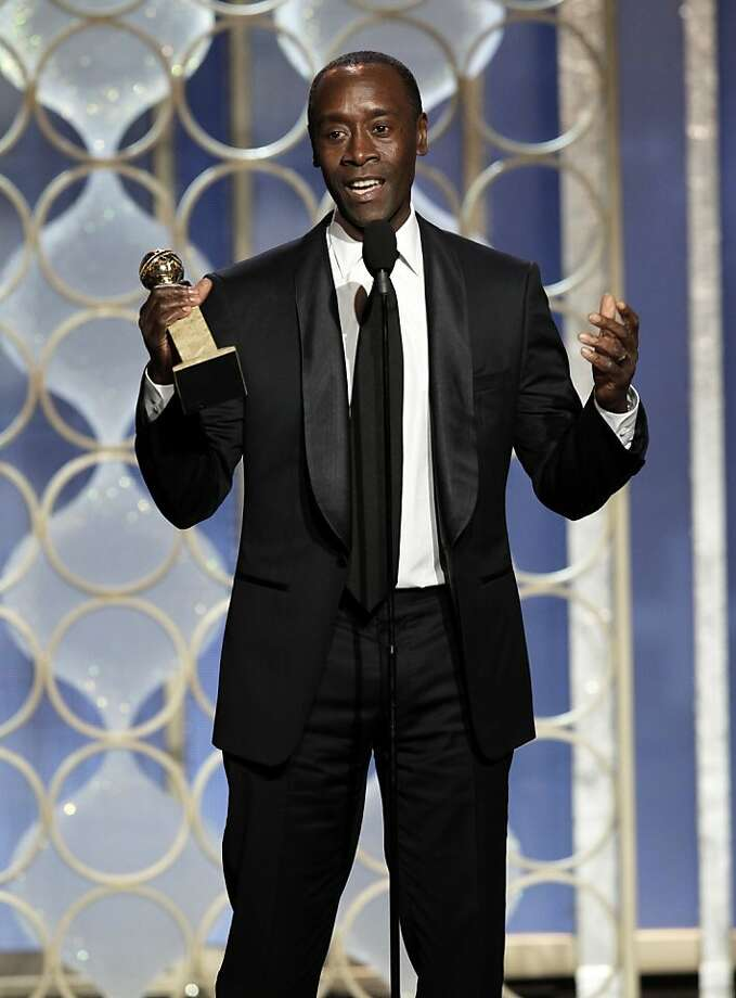 "This image released by NBC shows Don Cheadle with his award for best actor in a TV series, comedy or musical for his role in ""House of Lies"" during the 70th Annual Golden Globe Awards at the Beverly Hilton Hotel on Jan. 13, 2013, in Beverly Hills, Calif. (AP Photo/NBC, Paul Drinkwater) Photo: Paul Drinkwater, Associated Press"