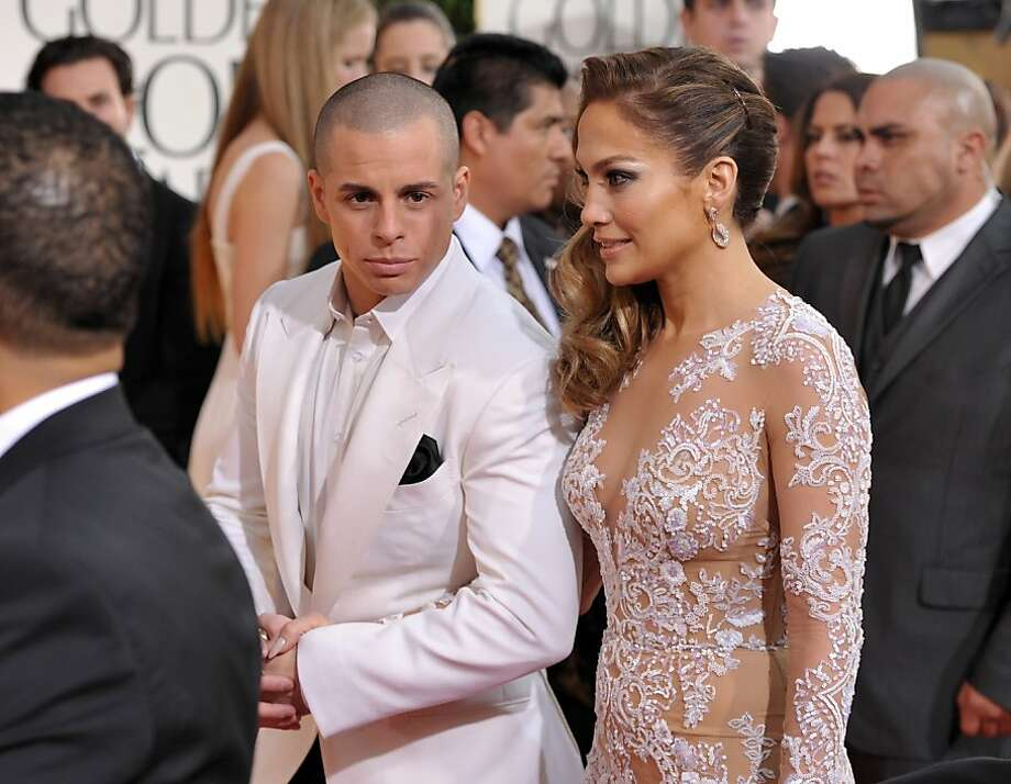 Actress/singer Jennifer Lopez, right, and Casper Smart arrive at the 70th Annual Golden Globe Awards at the Beverly Hilton Hotel on Sunday Jan. 13, 2013, in Beverly Hills, Calif. (Photo by John Shearer/Invision/AP) Photo: John Shearer, Associated Press