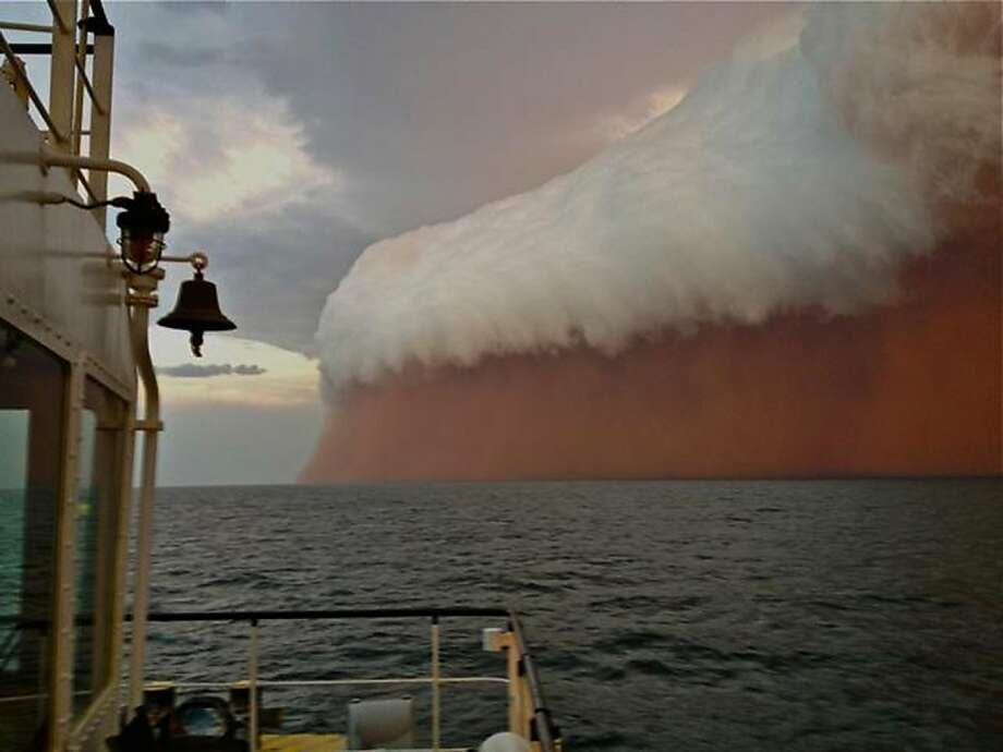 Batten down the hatches! A towering red dust storm approaches a tugboat off Onslow on the West Australian coast. Boat crewman Brett Martin, who captured the ominous picture 25 nautical miles from the town, said conditions were glassy and flat before the storm hit. But when the wild weather arrived, the swell lifted to two meters, winds increased to 40 knots and visibility was reduced to 100 meters. Photo: Brett Martin, AFP/Getty Images