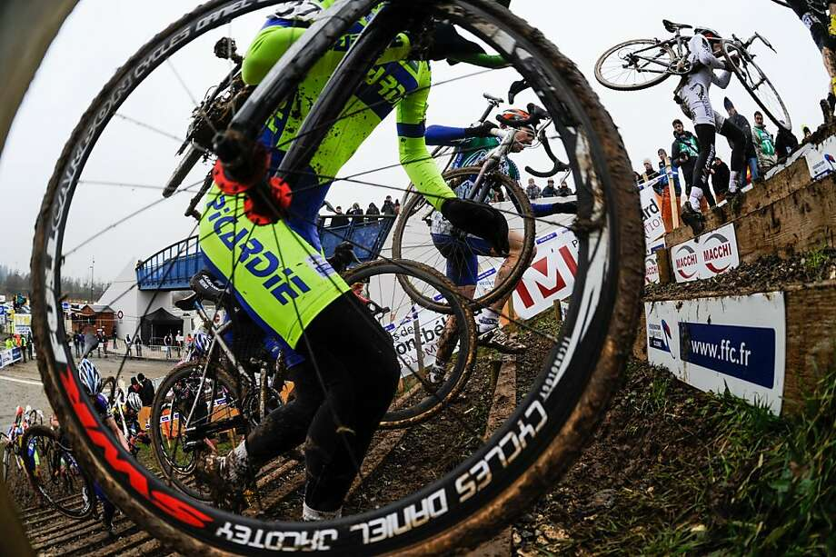 Cyclists compete during the French cyclo-cross championships on January 13, 2013 in Nommay. Photo: Sebastien Bozon, AFP/Getty Images