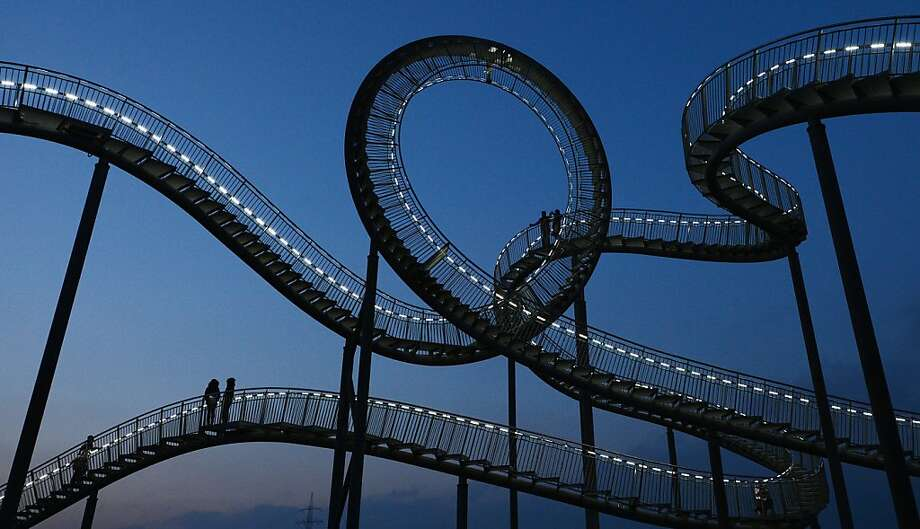 "The landmark ""Tiger & Turtle"" sculpture that resembles a roaller coaster is pictured at the former zinc smeltery's grounds Krupp Mannesmann in the Angerpark in Duisburg-Wanheim on January 13, 2013. 120 tons of galvanised steel are mounted and welded for the sculpture on the heap. The walkway area will amount to 220 metres including 249 steps. Photo: Patrik Stollarz, AFP/Getty Images"