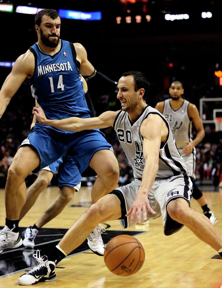 Spurs guard Manu Ginobili grimaces as he strains his left hamstring late in the second quarter against the Minnesota Timberwolves at the AT&T Center, Sunday, Jan. 13, 2013. Defending Ginobili was Nikola Pekovic‡. Photo: Jerry Lara, San Antonio Express-News / © 2013 San Antonio Express-News