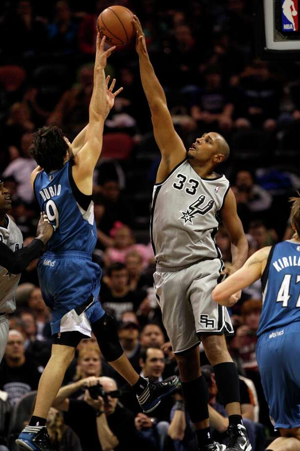 What looks like a good block, the Spurs' Boris Diaw is called for a foul against Minnesota Timberwolves' Ricky Rubio in the first half at the AT&T Center, Sunday, Jan. 13, 2013. Photo: Jerry Lara, San Antonio Express-News / © 2013 San Antonio Express-News