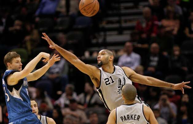The Spurs' Tim Duncan reaches out to try and block a pass by Minnesota Timberwolves' Luke Ridnour in the first half at the AT&T Center, Sunday, Jan. 13, 2013. Photo: Jerry Lara, San Antonio Express-News / © 2013 San Antonio Express-News