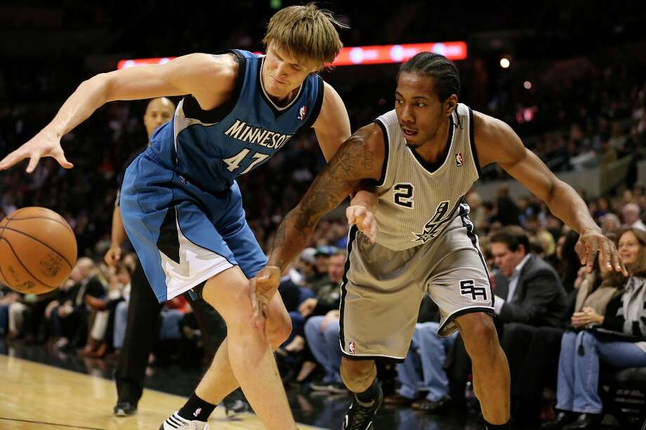 Minnesota Timberwolves' Andrei Kirilenko steal the ball from the Spurs' Kawhi Leonard in the first half at the AT&T Center, Sunday, Jan. 13, 2013. Photo: Jerry Lara, San Antonio Express-News / © 2013 San Antonio Express-News