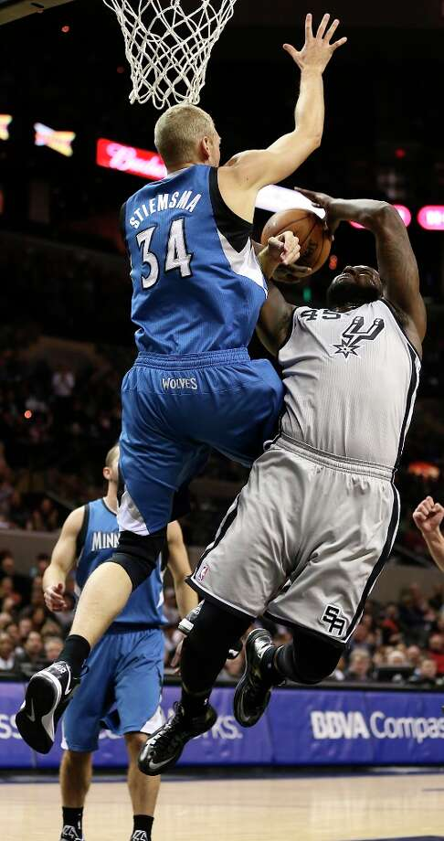 The Spurs' DeJuan Blair is blocked by Minnesota Timberwolves' Greg Stiemsma in the first half at the AT&T Center, Sunday, Jan. 13, 2013. Photo: Jerry Lara, San Antonio Express-News / © 2013 San Antonio Express-News