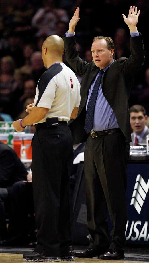 Spurs assistant coach Mike Budenholzer protests a call with official Marc Davis in the second half against the Minnesota Timberwolves at the AT&T Center, Sunday, Jan. 13, 2013. Earlier, in the half, Davis ejected head coach Gregg Popovich. The Spurs won 106-88. Photo: Jerry Lara, San Antonio Express-News / © 2013 San Antonio Express-News