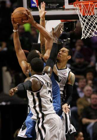 The Spurs' Danny Green, right, and Stephen Jackson attempt to stop Minnesota Timberwolves' Derrick Williams in the second half at the AT&T Center, Sunday, Jan. 13, 2013. The Spurs won 106-88. Photo: Jerry Lara, San Antonio Express-News / © 2013 San Antonio Express-News