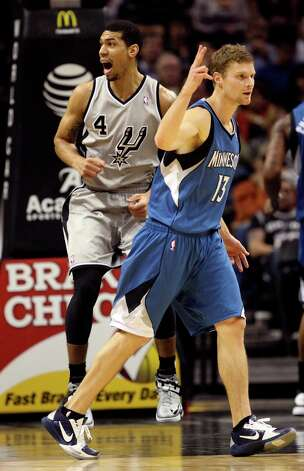The Spurs' Danny Green reacts to a foul call as Minnesota Timberwolves' Luke Ridnour signals two free shots in the second half at the AT&T Center, Sunday, Jan. 13, 2013. The Spurs won 106-88. Photo: Jerry Lara, San Antonio Express-News / © 2013 San Antonio Express-News