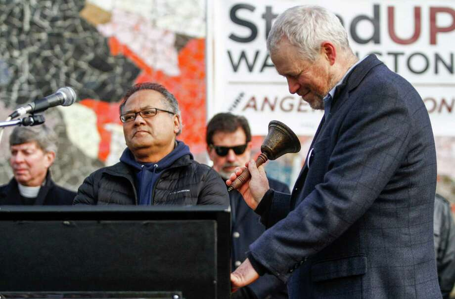Seattle's Mayor Mike McGinn rings honor of the victims at Sandy Hook during a Seattle march against gun violence in January.  McGinn is mounting the bully pulpit, on topics ranging from gun control to coal exports, as he runs for a second term. Photo: NICK ADAMS, FOR SEATTLEPI.COM / SEATTLEPI.COM