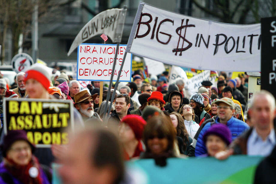 A crowd marches to the Seattle Center during the StandUp Washington March and Rally for Gun Control on Sunday, January 13, 2013 in Seattle. Marchers called for sensible gun control laws in the wake of the tragic shooting at Sandy Hook Elementary School in Connecticut. Photo: NICK ADAMS, FOR SEATTLEPI.COM / SEATTLEPI.COM