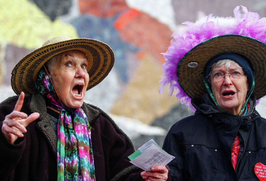 Raging Grannies Carolyn Hale, left, and Nina Murano sing Read our lips! No more guns, during the StandUp Washington March and Rally for Gun Control on Sunday, January 13, 2013 in Seattle. Marchers called for sensible gun control laws in the wake of the tragic shooting at Sandy Hook Elementary School in Connecticut. Photo: NICK ADAMS, FOR SEATTLEPI.COM / SEATTLEPI.COM