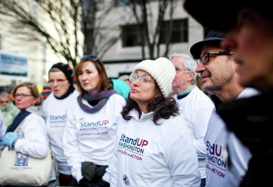 Volunteers for the StandUp Washington March and Rally for Gun Control listen to organizers before the start on Sunday, January 13, 2013 in Seattle. Marchers called for sensible gun control laws in the wake of the tragic shooting at Sandy Hook Elementary School in Connecticut. Photo: NICK ADAMS, FOR SEATTLEPI.COM / SEATTLEPI.COM