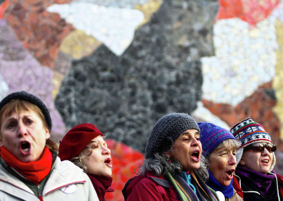 Seattle Peace Chorus sings the final song at the end of the StandUp Washington March and Rally for Gun Control on Sunday, January 13, 2013 in Seattle. Marchers called for sensible gun control laws in the wake of the tragic shooting at Sandy Hook Elementary School in Connecticut. Photo: NICK ADAMS, FOR SEATTLEPI.COM / SEATTLEPI.COM
