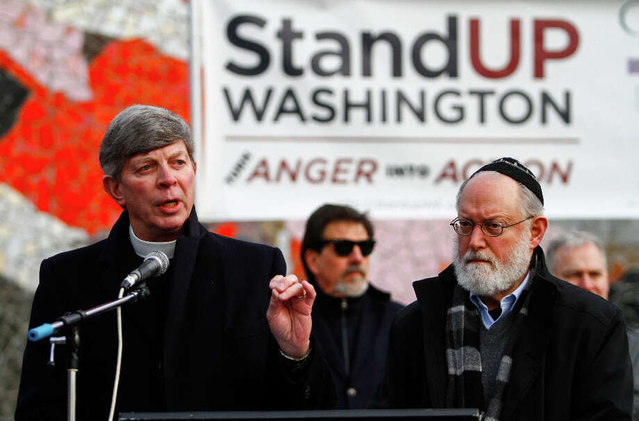 Interfaith Amigos Pastor Don Mackenzie speaks about faith and guns during the StandUp Washington March and Rally for Gun Control on Sunday, January 13, 2013 in Seattle. Marchers called for sensible gun control laws in the wake of the tragic shooting at Sandy Hook Elementary School in Connecticut. Photo: NICK ADAMS, FOR SEATTLEPI.COM / SEATTLEPI.COM