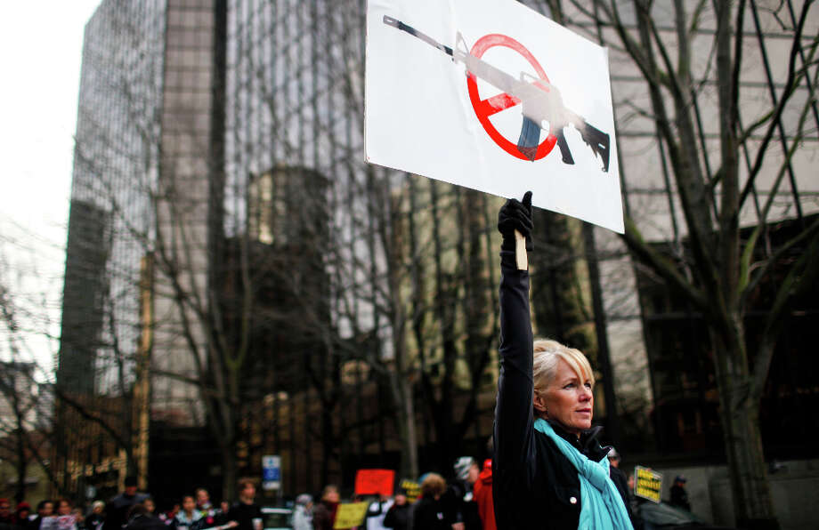 Diane Vallentyne Watson holds up a assault ban sing during the StandUp Washington March and Rally for Gun Control on Sunday, January 13, 2013 in Seattle. Marchers called for sensible gun control laws in the wake of the tragic shooting at Sandy Hook Elementary School in Connecticut. Photo: NICK ADAMS, FOR SEATTLEPI.COM / SEATTLEPI.COM