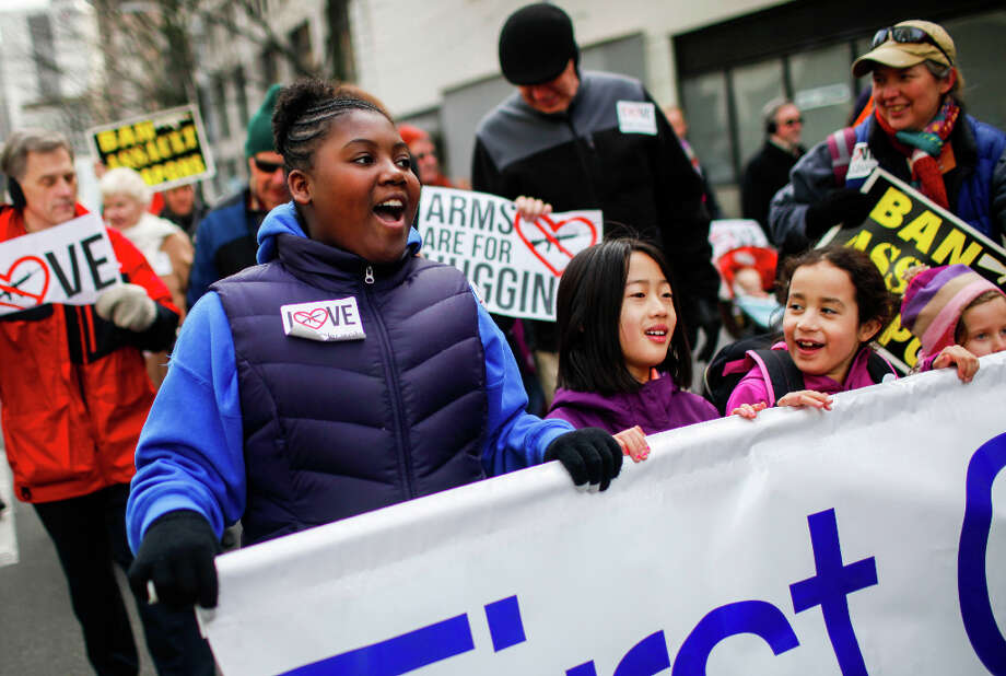 Aaliyah Soukup-Stone, 11, left, walks with First Church during the StandUp Washington March and Rally for Gun Control on Sunday, January 13, 2013 in Seattle. Marchers called for sensible gun control laws in the wake of the tragic shooting at Sandy Hook Elementary School in Connecticut. Photo: NICK ADAMS, FOR SEATTLEPI.COM / SEATTLEPI.COM