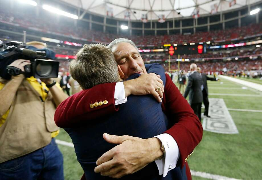 Atlanta Falcons owner Arthur Blank embraces Atlanta Falcons General Manager Thomas Dimitroff after the second half of an NFC divisional playoff NFL football game against the Seattle Seahawks Sunday, Jan. 13, 2013, in Atlanta. The Falcons won 30-28. (AP Photo/John Bazemore) Photo: John Bazemore, Associated Press