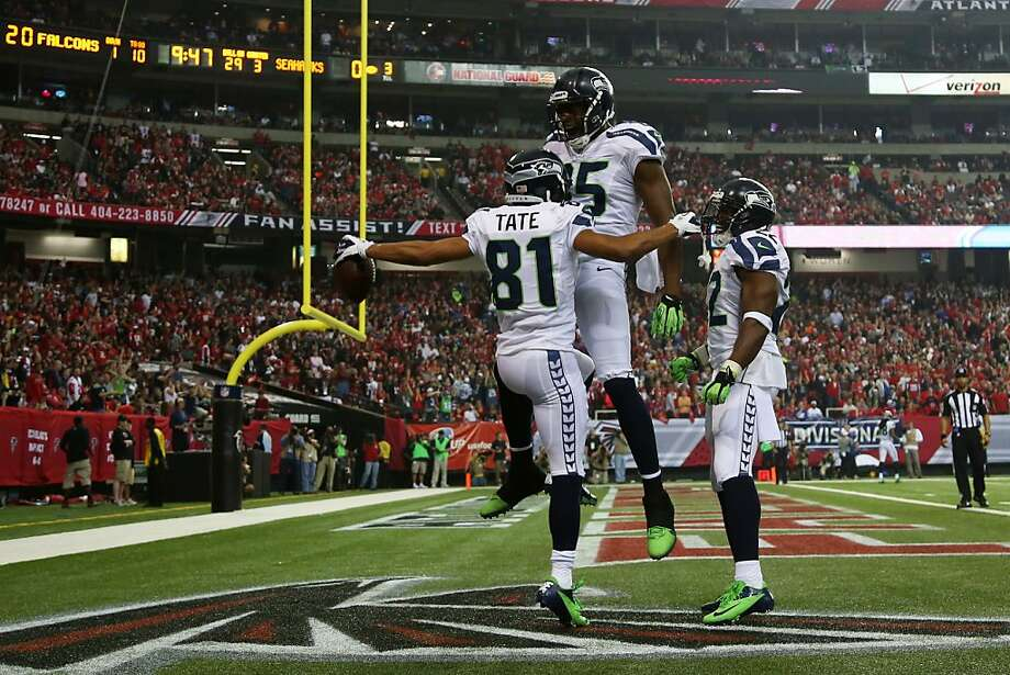 ATLANTA, GA - JANUARY 13:  Golden Tate #81 celebrates his third quarter touchdown with  Anthony McCoy #85 of the Seattle Seahawks during the NFC Divisional Playoff Game against the Atlanta Falcons at Georgia Dome on January 13, 2013 in Atlanta, Georgia.  (Photo by Mike Ehrmann/Getty Images) Photo: Mike Ehrmann, Getty Images