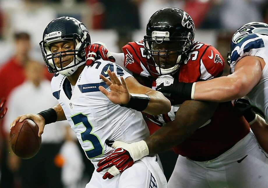ATLANTA, GA - JANUARY 13:  Jonathan Babineaux #95 of the Atlanta Falcons sacks  Russell Wilson #3 of the Seattle Seahawks in the second quarter during the NFC Divisional Playoff Game at Georgia Dome on January 13, 2013 in Atlanta, Georgia.  (Photo by Kevin C. Cox/Getty Images) Photo: Kevin C. Cox, Getty Images