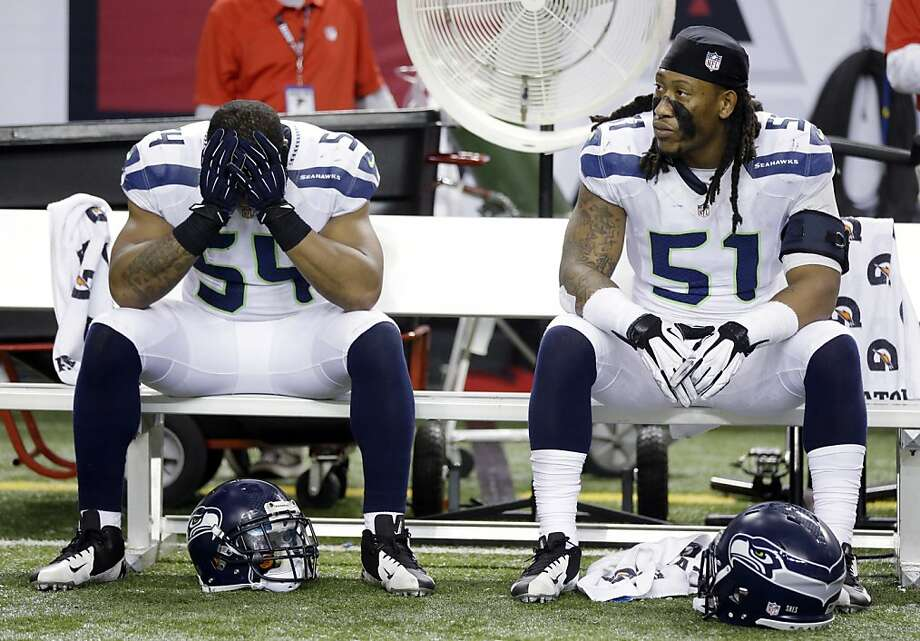 Seattle Seahawks middle linebacker Bobby Wagner (54) and defensive end Bruce Irvin (51) sit on the bench during the second half of an NFC divisional playoff NFL football game against the Atlanta Falcons Sunday, Jan. 13, 2013, in Atlanta. The Falcons won 30-28. (AP Photo/David Goldman) Photo: David Goldman, Associated Press