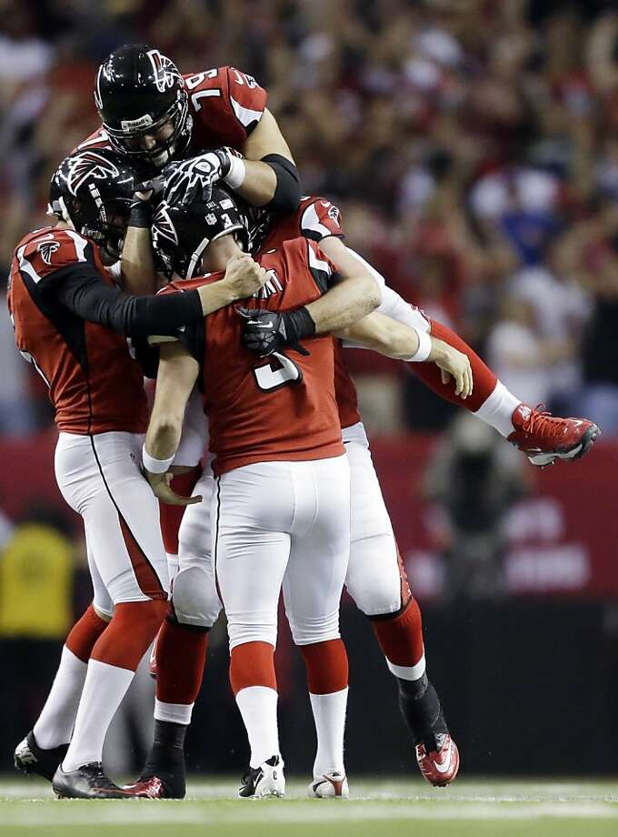 Atlanta Falcons kicker Matt Bryant (3) is congratulated by teammates after making the game-winning field goal during the second half of an NFC divisional playoff NFL football game against the Seattle Seahawks Sunday, Jan. 13, 2013, in Atlanta. The Falcons won 30-28. (AP Photo/David Goldman) Photo: David Goldman, Associated Press