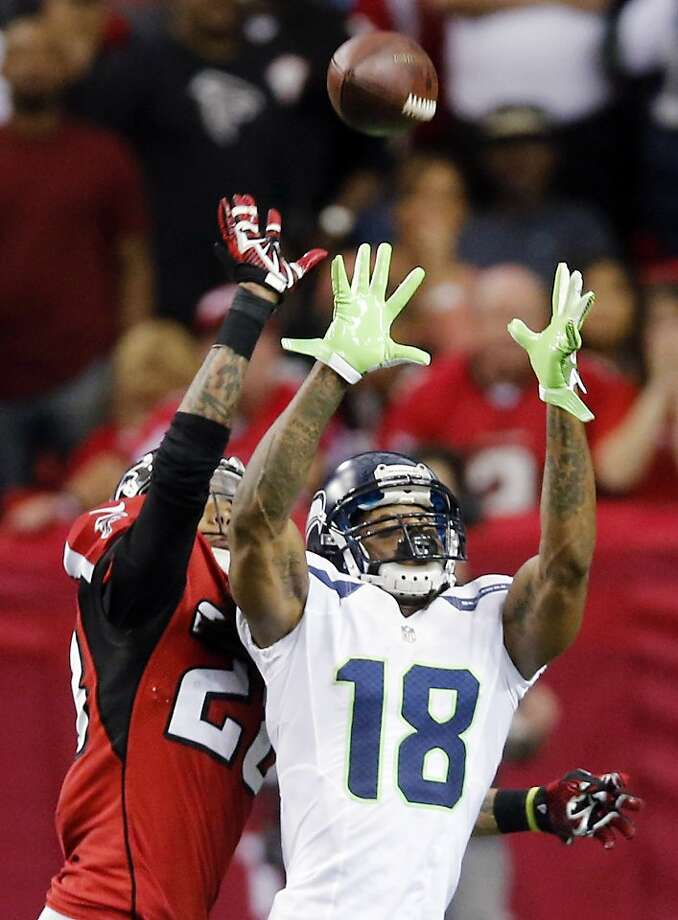 Seattle Seahawks wide receiver Sidney Rice (18) makes the catch as Atlanta Falcons free safety Thomas DeCoud (28) defends during the second half of an NFC divisional playoff NFL football game Sunday, Jan. 13, 2013, in Atlanta. (AP Photo/John Bazemore) Photo: John Bazemore, Associated Press