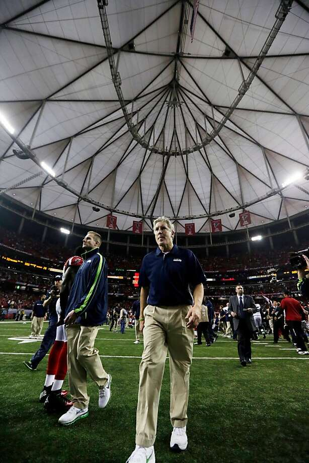 Seattle Seahawks head coach Pete Carroll walks off the field after an NFC divisional playoff NFL football game against the Atlanta Falcons Sunday, Jan. 13, 2013, in Atlanta. The Falcons won 30-28. (AP Photo/Dave Martin) Photo: Dave Martin, Associated Press
