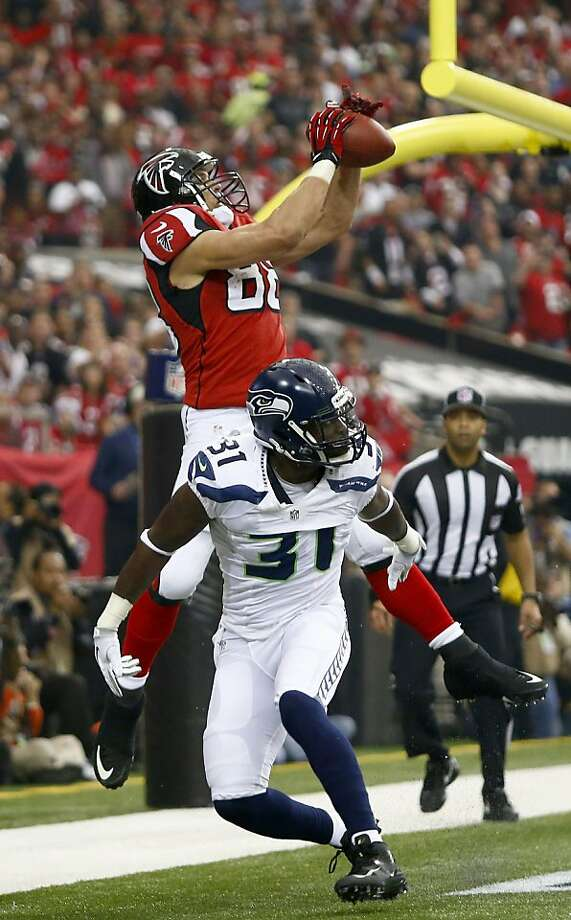 Tony Gonzalez caught a first-quarter touchdown pass in the Falcons' 30-28 win over the Seahawks. It was his first playoff victory in six tries. Photo: Dean Rutz, McClatchy-Tribune News Service