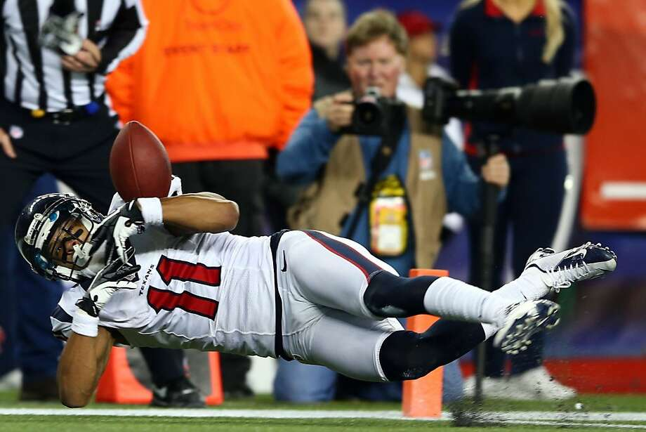 FOXBORO, MA - JANUARY 13:  DeVier Posey #11 of the Houston Texans brings in a catch for a touchdown in the fourth quarter against the New England Patriots during the 2013 AFC Divisional Playoffs game at Gillette Stadium on January 13, 2013 in Foxboro, Massachusetts.  (Photo by Elsa/Getty Images) Photo: Elsa, Getty Images