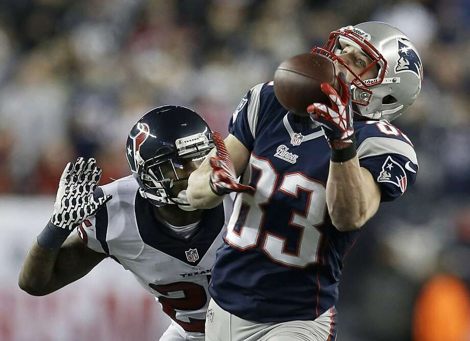 New England Patriots wide receiver Wes Welker (83) pulls in a 47-yard pass from Tom Brady as Houston Texans cornerback Kareem Jackson chases him during the first half of an AFC divisional playoff NFL football game in Foxborough, Mass., Sunday, Jan. 13, 2013. (AP Photo/Elise Amendola) Photo: Elise Amendola, Associated Press