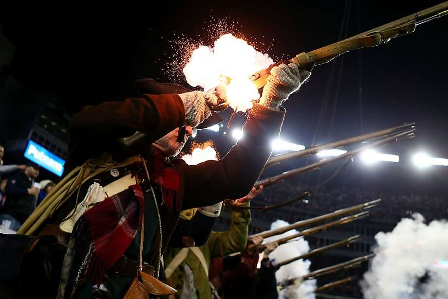 "FOXBORO, MA - JANUARY 13:  The ""End Zone Militia"" of the New England Patriots fire their guns during the 2013 AFC Divisional Playoffs game at Gillette Stadium on January 13, 2013 in Foxboro, Massachusetts.  (Photo by Elsa/Getty Images) Photo: Elsa, Getty Images"