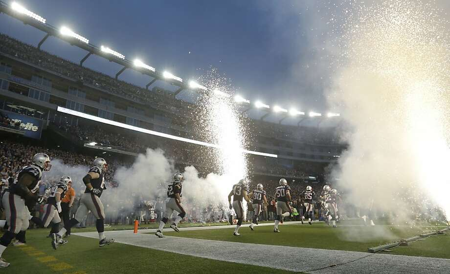 The New England Patriots take the field at Gillette Stadium prior to an AFC divisional playoff NFL football game against the Houston Texans in Foxborough, Mass., Sunday, Jan. 13, 2013. (AP Photo/Elise Amendola) Photo: Elise Amendola, Associated Press