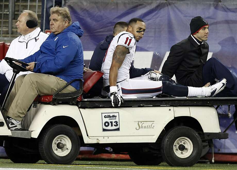 Houston Texans wide receiver DeVier Posey is taken off the field on a cart after an injury during the second half of an AFC divisional playoff NFL football game against the New England Patriots in Foxborough, Mass., Sunday, Jan. 13, 2013. (AP Photo/Stephan Savoia) Photo: Stephan Savoia, Associated Press