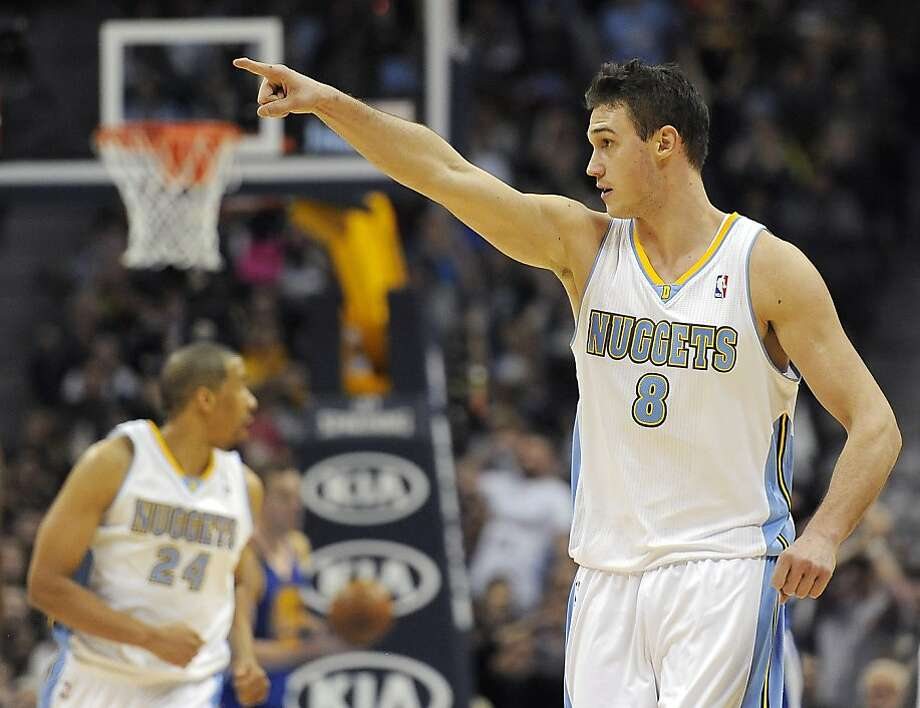 Denver Nuggets forward Danilo Gallinari, of Italy, celebrates a three-pointer in the second half of an NBA basketball game against the Golden State Warriors on Sunday, Jan. 13, 2013, in Denver. The Nuggets won 116-105. (AP Photo/Chris Schneider) Photo: Chris Schneider, Associated Press
